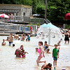 Crowds swarm Harold Hall Quarry Beach in Batavia Monday afternoon.
