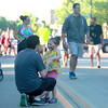 Jordan Manier dances with his daughter, Caitlyn, 3, as they wait for the band 7th Heaven to begin during the Swedish Days Festival Tuesday evening in Geneva.