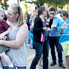 Stephanie Burgess dances with her son, Evan, 2, as the band 7th Heaven performs during the Swedish Days Festival Tuesday evening in Geneva.