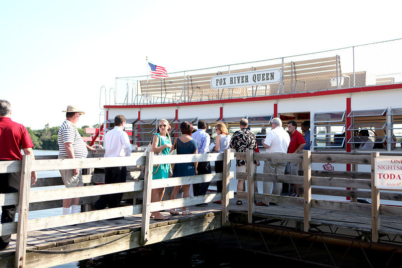 Members of the St. Charles Chamber of Commerce board the Fox River Queen for the 22nd annual Paddleboat Mixer Wednesday evening.