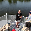 Ellen Gallagher chats with Chuck Ingersoll during the 22nd annual Paddleboat Mixer hosted by the St. Charles Chamber of Commerce Wednesday evening.