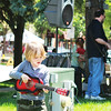 Shea Callery, 4, of Chicago strums his guitar during Concerts on the Lawn at the Swedish Days Festival in Geneva Tuesday.