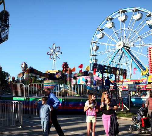 Crowds enter the carnival area during the Swedish Days Festival Tuesday evening in Geneva.