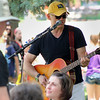 Dennis O'Brien plays the guitar and entertains crowds with classic songs as a part of the Concerts on the Lawn during Geneva's annual Swedish Days festival on Wednesday. O'Brien performed songs from multiple genres, including rock, blues, and folk.