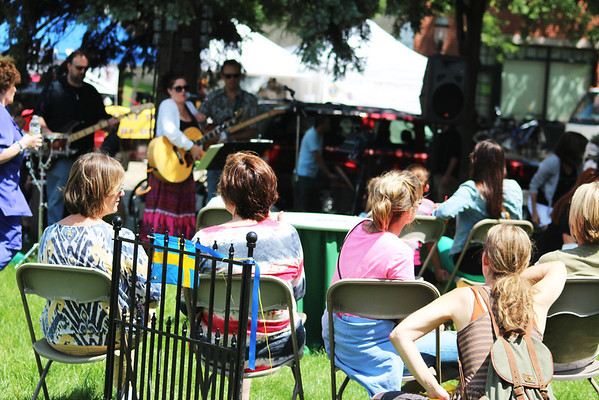 Festival-goers watch Lindsey O'Brien perform during the Concerts on the Lawn series at the Swedish Days Festival in Geneva Tuesday.
