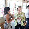 Yvonne Irving chats with Ramana Grauzinis during the 22nd annual Paddleboat Mixer hosted by the St. Charles Chamber of Commerce Wednesday evening.