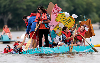 Kyle Grillot - kgrillot@shawmedia.com   Participants compete on a boat named Thrift Shop during the 29th annual America's Cardboard Cup Regatta at the Crystal Lake Park District's Main Beach June 22, 2013. The competition raises money for local charities, contributing more than $500,000 since the first event. Entry fees are $20 per family and $200 per business with a $3 general admission fee per person that is capped at $15 per family. The event draws more than 2,000 people per year.