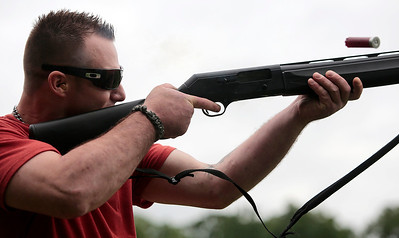 Kyle Grillot - kgrillot@shawmedia.com   Navy veteran Jay Veltri of Milwaukee fires a shotgun during the first annual Joe's Wish shootout for paralyzed veterans Saturday at the McHenry Sportsman's Club. Joe's Wish, a nonprofit that helps area veterans hosted the event and McHenry Sportsman's Club donated their facilities, staff, and clays.