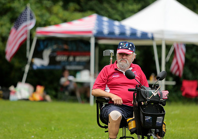 Kyle Grillot - kgrillot@shawmedia.com   Army veteran John Schneck waits while other veterans shoot shotguns during the first annual Joe's Wish shootout for paralyzed veterans Saturday at the McHenry Sportsman's Club. Joe's Wish, a nonprofit that helps area veterans hosted the event and McHenry Sportsman's Club donated their facilities, staff, and clays.