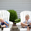 Brothers Joey, 3, and Jason Jakstys enjoy their ice cream outside Graham's Chocolate during the Swedish Days Festival in Geneva Thursday.