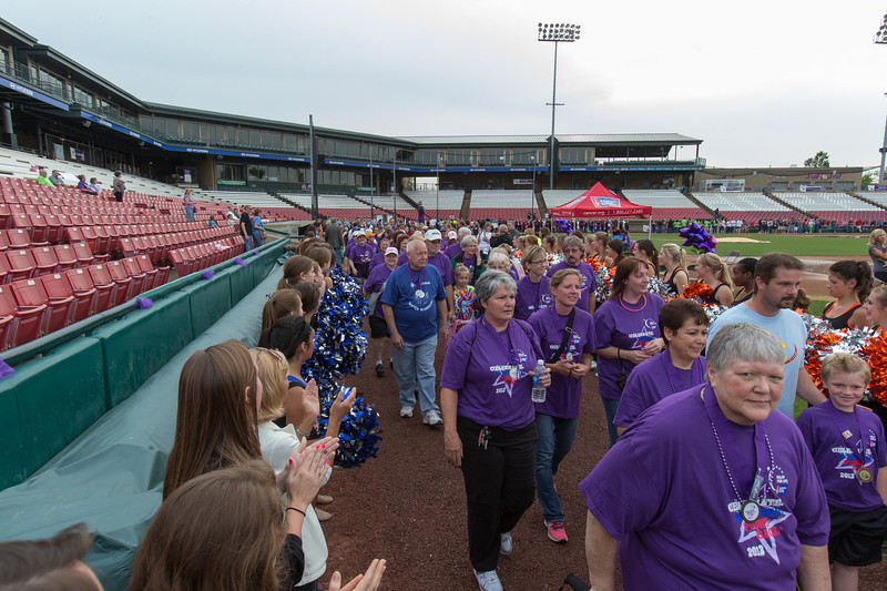 Cancer survivors walk around the ball park while being cheered by family members and caregivers during the 2013 relay for life at Fifth Third Bank Ballpark in Geneva, IL on Friday, June 21, 2013 (Sean King for Shaw Media)
