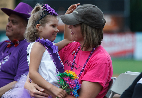 Co-Honoree Carinne Forpanek 6, thanks her mom and caregiver Cassandra Forpanek for taking care of her while she had cancer at the 2013 relay for life at Fifth Third Bank Ballpark in Geneva, IL on Friday, June 21, 2013 (Sean King for Shaw Media)