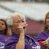 Cancer survivor for 38 years Dorie Hunt of Batavia celebrates by blowing bubbles before the start of the 2013 relay for life at Fifth Third Bank Ballpark in Geneva, IL on Friday, June 21, 2013 (Sean King for Shaw Media)