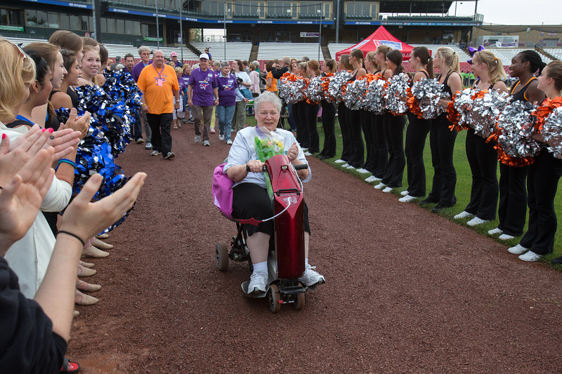 5 Year Cancer Survivor TGeri Caron from Elburn is congratulated by a cheering crowd during the surveyor lap at the 2013 relay for life at Fifth Third Bank Ballpark in Geneva, IL on Friday, June 21, 2013 (Sean King for Shaw Media)