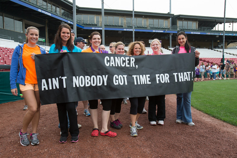 Team Cancer, Ain't Nobody for time for that! display their sign while participating in the caregiver lap at the 2013 relay for life at Fifth Third Bank Ballpark in Geneva, IL on Friday, June 21, 2013 (Sean King for Shaw Media)