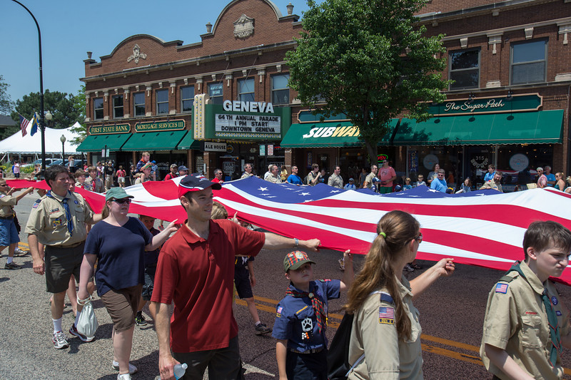 The American Flag on loan from The North Aurora Fire Department was displayed by Boy Scouts during The 64th Annual Swedish Days Parade in Geneva, IL on Sunday, June 23, 2013 (Sean King for Shaw Media)
