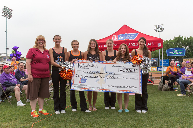 The St. Charles East and North Drill Teams present a check for the American Cancer Society at the 2013 relay for life at Fifth Third Bank Ballpark in Geneva, IL on Friday, June 21, 2013 (Sean King for Shaw Media)