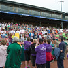 Cancer caregivers stand to receive recognition from cancer survivors at the 2013 relay for life at Fifth Third Bank Ballpark in Geneva, IL on Friday, June 21, 2013 (Sean King for Shaw Media)
