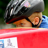 Rhett Laverty, 8, of Sugar Grove, prepares himself before competing in a soap box derby race along Second Street in downtown Geneva as a part of Geneva's annual Swedish Days Festival on Saturday. The racers competed in a bracket format, with the winners advancing to the next round.