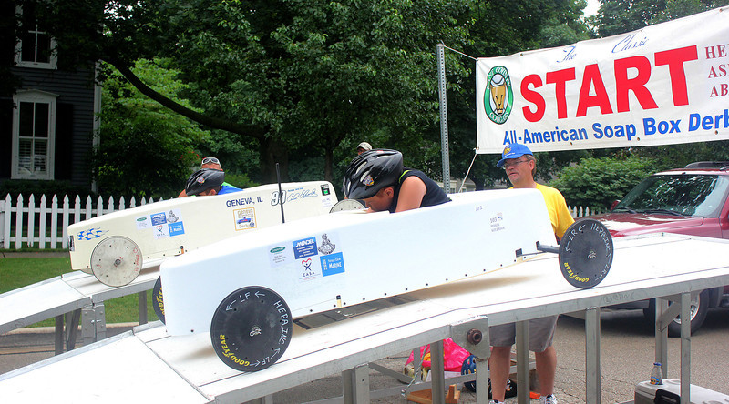 Racers leave the ramps at the start of a heat in the soap box derby race in downtown Geneva on Saturday. Area children between the ages of 7 and 13 competed by racing down a stretch of Second Street in personalized cars, constructed out of kits.