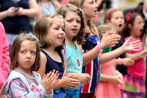 Fans stand close to the Center Stage to hear Radio Disney star Shealeigh sing during Geneva's annual Swedish Days Festival on Friday. Even though rain caused the Kids Parade to be canceled, Shealeigh was able to perform for her fans.