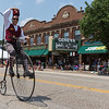A member of the Medinah Shriners rides an old penny-farthing bike during The 64th Annual Swedish Days Parade in Geneva, IL on Sunday, June 23, 2013 (Sean King for Shaw Media)
