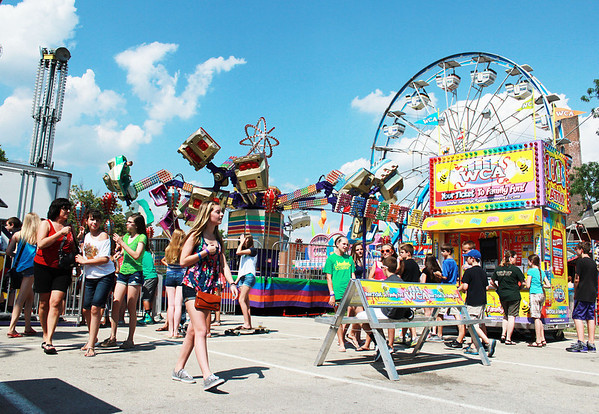 Festival goers enjoy the carnival at the Swedish Days Festival Thursday in downtown Geneva despite the hot weather.