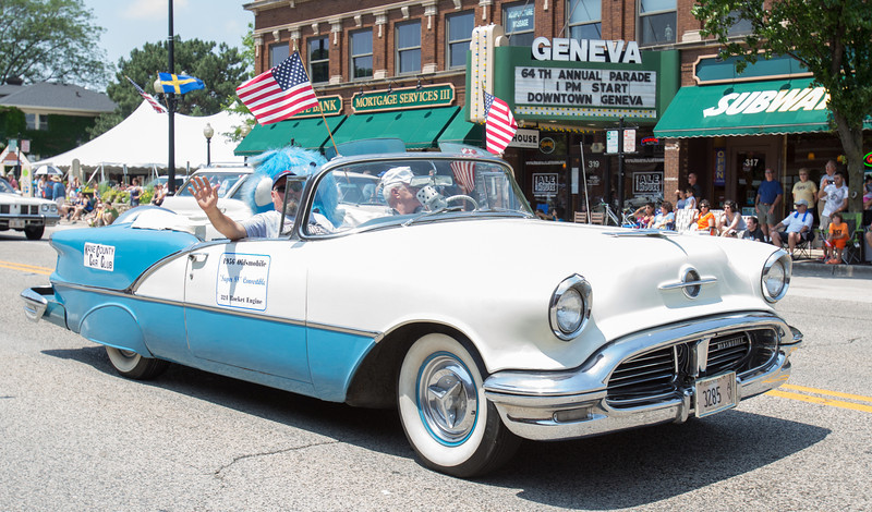Members of the Kane County Car Club drive a 1956 Oldsmobile Super 88 Convertible during The 64th Annual Swedish Days Parade in Geneva, IL on Sunday, June 23, 2013 (Sean King for Shaw Media)