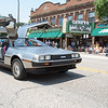 A member of the Kane County Car Club drives a DeLorean DMC-12 during The 64th Annual Swedish Days Parade in Geneva, IL on Sunday, June 23, 2013 (Sean King for Shaw Media)