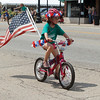 A member of the Mill Race Cycle team at The 64th Annual Swedish Days Parade in Geneva, IL on Sunday, June 23, 2013 (Sean King for Shaw Media)