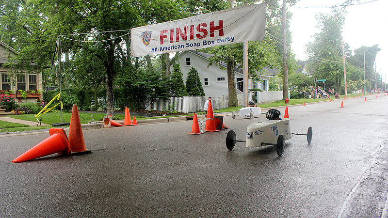 Racers head into the finish line at the end of a race in a soap box derby race along Second Street in downtown Geneva as a part of Geneva's annual Swedish Days Festival. The race was sponsored by local businesses and led by the Kiwanis volunteer organization and the All-American Soap Box Derby.