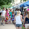 Shoppers browse Third Street during the Swedish Days Festival in Geneva Thursday.