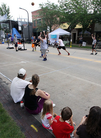 Jeff Krage – For Shaw Media<br /> People watch the Geneva Park District's 3-on-3 basketball tournament during Saturday's Swedish Days. <br /> Geneva 6/22/13