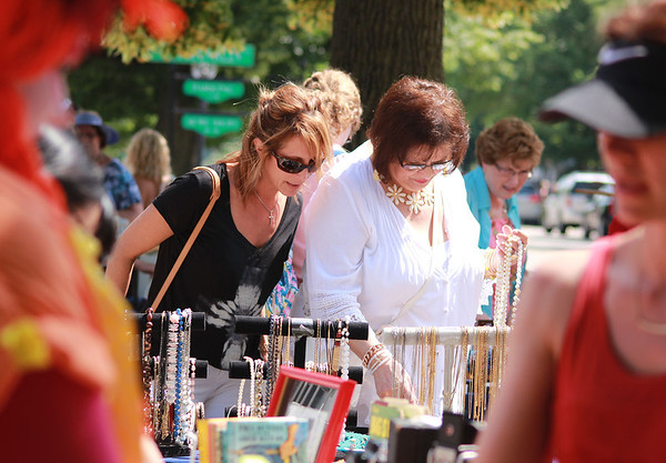 St. Charles resident Tina Chorneyko and her mother, Cookie Bibbiano, of Chicago, shop for jewelry at the Swedish Days Festival Thursday in downtown Geneva.