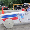 Drew Freedlund, 7, from Batavia, races past his opponent during a heat of the soap box derby race, a part of Geneva's annual Swedish Days Festival on Saturday.  Soap box derby cars have no motors, and rely on gravity to move, which makes hills the primary spot to hold races.