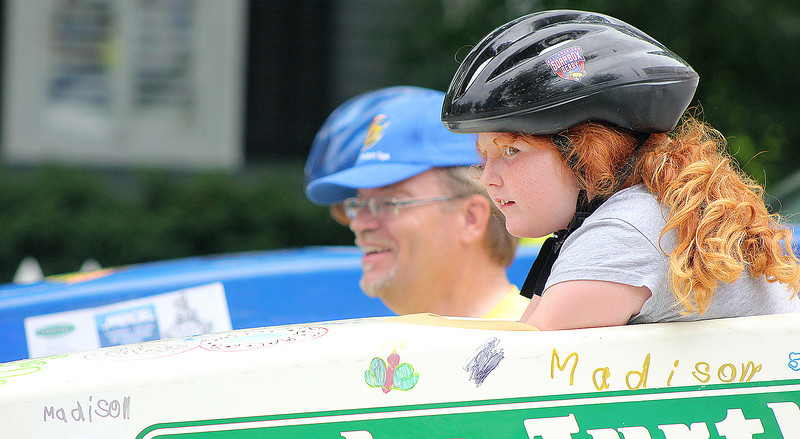 Madison Holbrook, 7, of St. Charles prepares for her first run in the soap box derby race along Second Street in downtown Geneva on Saturday. The competition marked the first time that the soap box derby was featured in Geneva's annual Swedish Days Festival.