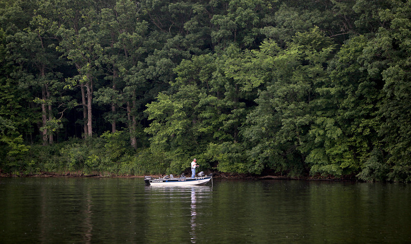 A fisherman waits for a catch on the Fox River near Ferson Creek Park in St. Charles.