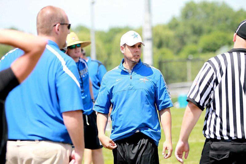 St. Charles North Head Coach Rob Pomazak (center) walks the sideline during the Red Grange Classic 7-on-7 Tournament Challenge Thursday at Wheaton Warrenville South High School.