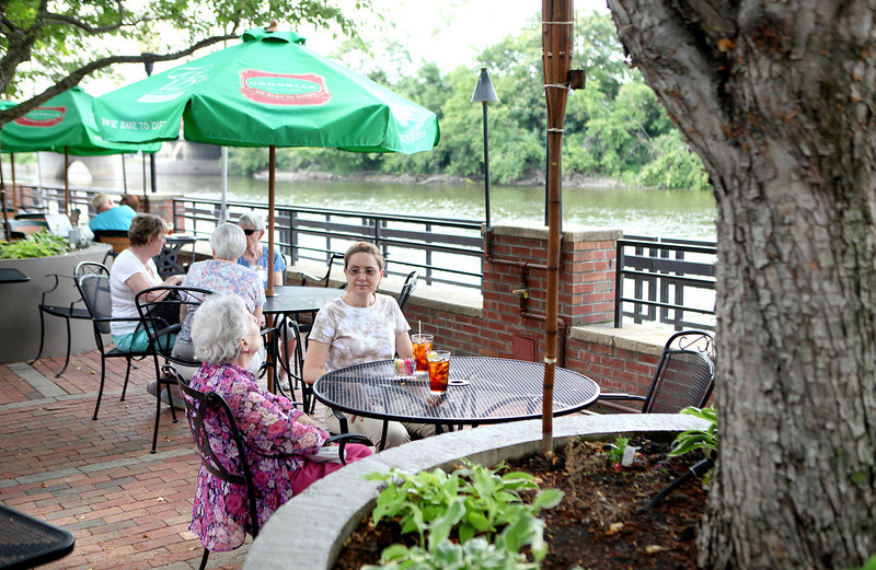 Marie Peck and Cheryl Ano enjoy their iced teas while sitting on the patio overlooking the Fox River at Pal Joey's in Batavia.