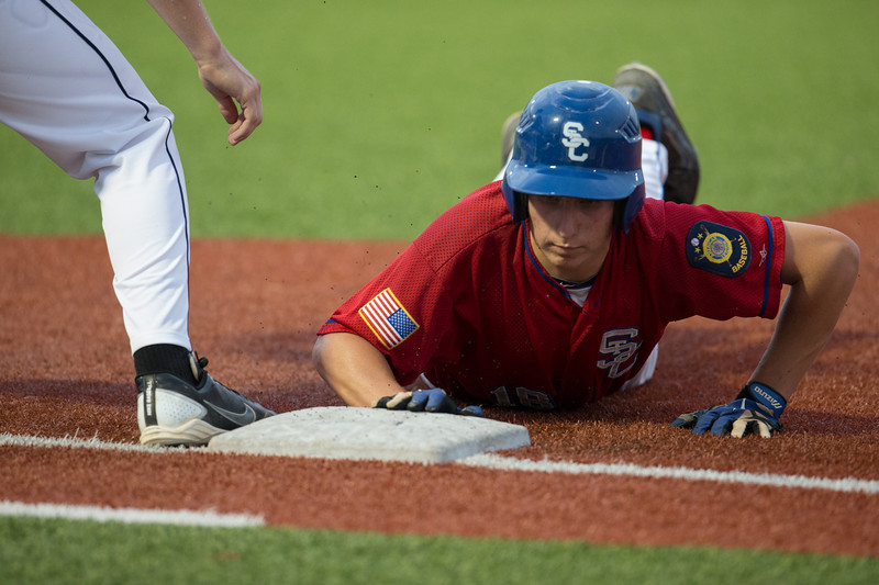 St. Charles Post 342's Tim Misner (18) dives back to first to avoid a pick off play at American Legion Baseball Field in Wheaton, IL on Tuesday, June 25, 2013 (Sean King for Shaw Media)