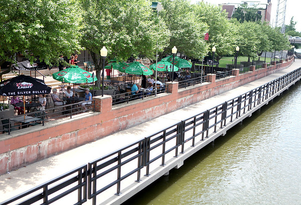 Diners relax on the patio overlooking the Fox River at Pal Joey's in Batavia.