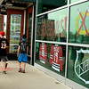 Customers and fans of Chicago Blackhawks hockey walk into Dick's Sporting Goods to purchase Chicago Blackhawks gear after the Stanley Cup Finals Tuesday at the Geneva Commons in Geneva.