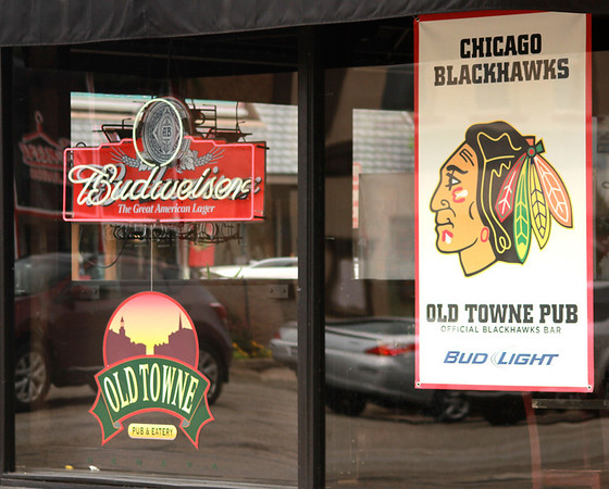 A Chicago Blackhawks sign hangs in the window of Old Towne Pub & Eatery after the Stanley Cup Finals Tuesday.