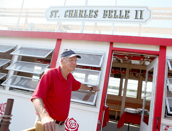 Rich Anderson welcomes passengers aboard the St. Charles Belle II paddleboat on the Fox River.
