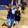 Jeff Krage – For Shaw Media<br /> Geneva's Michael Landi catches a pass Wednesday during a game against Sycamore at the Geneva High School Summer Basketball Tournament.<br /> Geneva 6/26/13