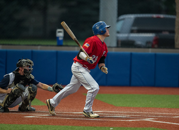 St. Charles Post 342's hits an RBI Single against Wheaton <br /> at American Legion Baseball Field in Wheaton, IL on Tuesday, June 25, 2013 (Sean King for Shaw Media)
