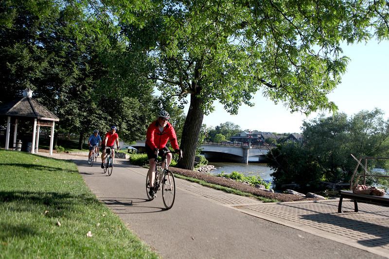 Bikers travel the Fox River Trail in Geneva.