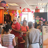 Patrons crowd the St. Charles branch of Dunkin' Donuts on Main Street during their grand re-opening ceremony on Friday. The store offered doughnuts and coffee for 25 cents; prices similar to what the branch offered when it first opened over 20 years ago.