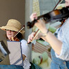 Deb Meitl (left) and Connie Miller, both of Geneva, play their violins during the opening day of the Geneva Green Market.
