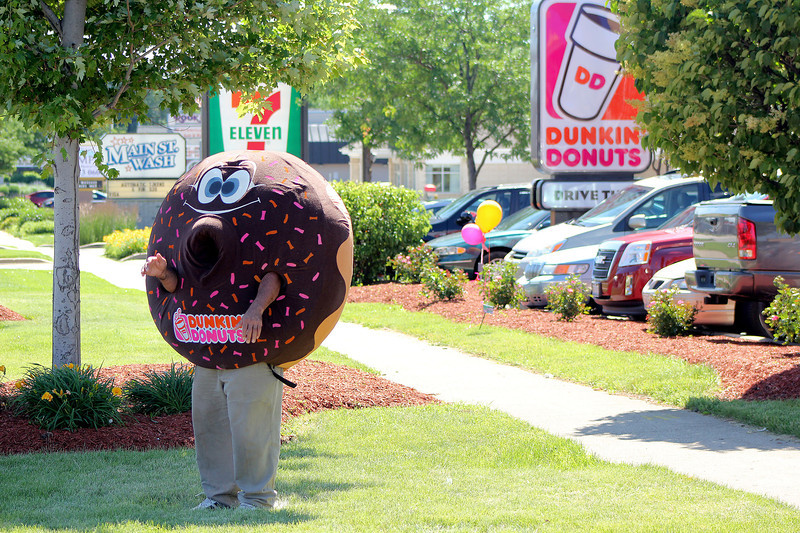 The Dunkin' Donuts mascot stands outside to entice customers to the grand re-opening celebration at the St. Charles store, located on Main Street on Friday. The St. Charles branch celebrated their re-opening over Friday and Saturday with doughnuts and coffee for 25 cents, as well as games for kids.